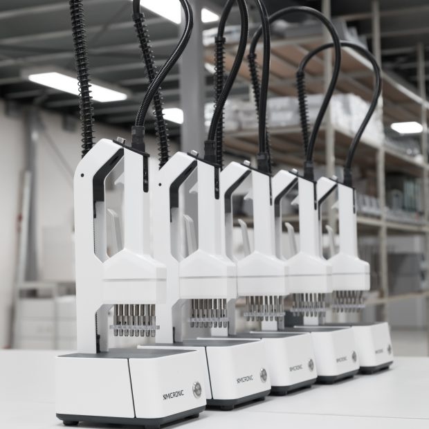 A row of CS500 Screw Cap Recappers by Micronic