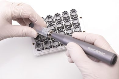 The CS100 Screw Cap Recapper by Micronic being used to decap an externally threaded tube precapped with a grey screw cap