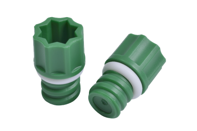 Two green internally threaded screw caps