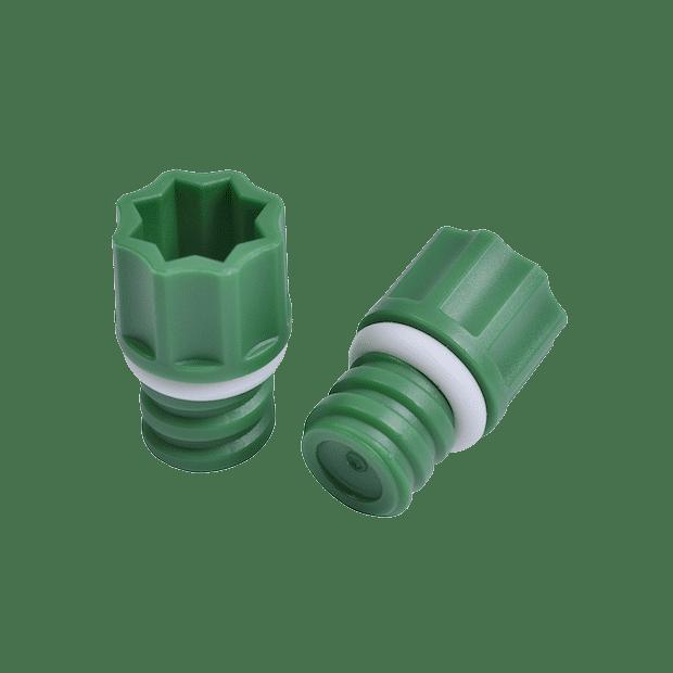Two green internally threaded screw caps